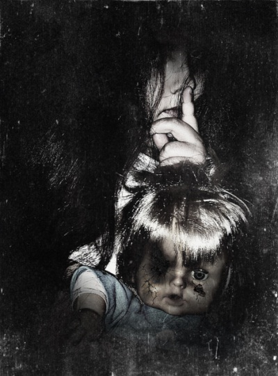 girl with doll hearing sounds - haunted house signs