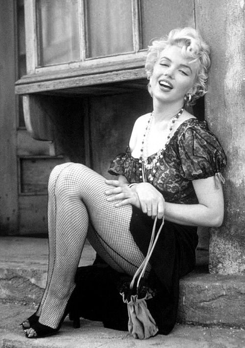 Marilyn Monroe sitting down