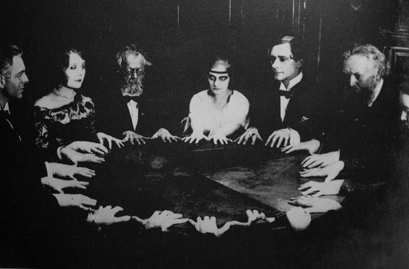 Group conducting a seance