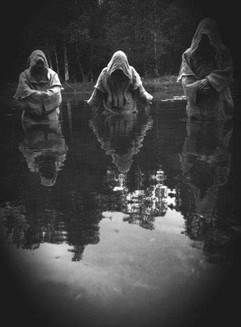 Cult members hailing their dark god