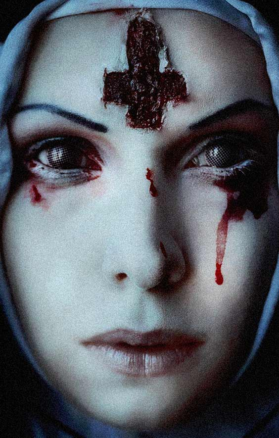 The nun had a cross carved out of her forehead and strange looking eyes.
