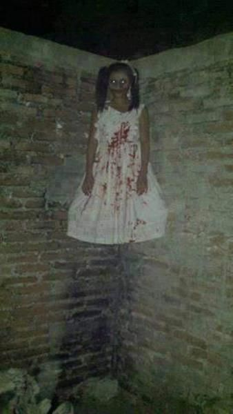 The little girl with blood on her dress appeared to be floating in the corner of the Magic Landing theme park in Texas.