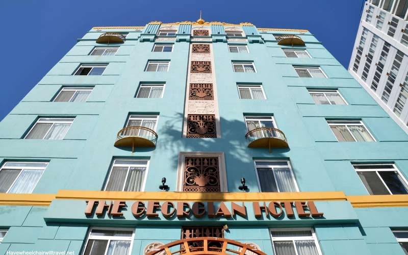 The Georgian Hotel sticks out like a sore thumb due to it's bright blue color and gold trim, but once you get inside there's a sweeping dull feeling that will take you over.
