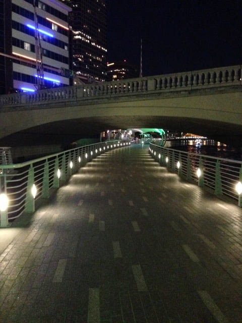 The Riverwalk in Tampa, FL has some incredible views, it's nicely lit, and it's great exercise. Especially when you're running away from disembodies voices.
