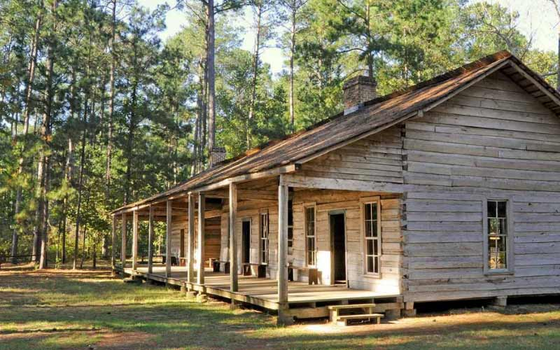 This Mission is a wooden building in the midle of a state park. Grapeland, Texas is where you'll find it.
