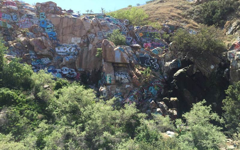 There's a Junkie Ghost at the Graffiti Waterfall in Riverside, CA.