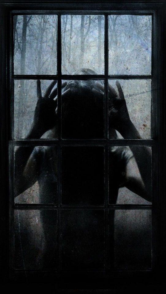 Ghost peering through a cabin window.