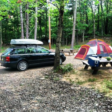 Car camping roof rack in use and cooler