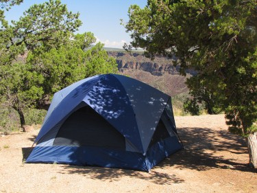Choosing a shaded spot to set up your tent will help keep it cool.